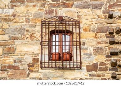 Window with bars. Tower of the Osorio. Turienzo de los Caballeros, Leon, Spain.