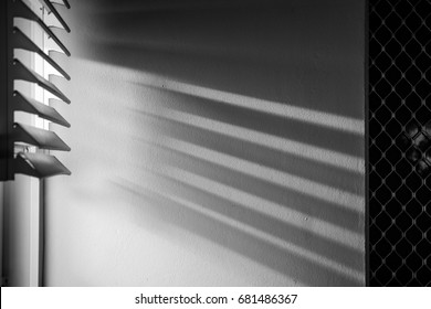 window-blind-shadows-wall-260nw-68148636