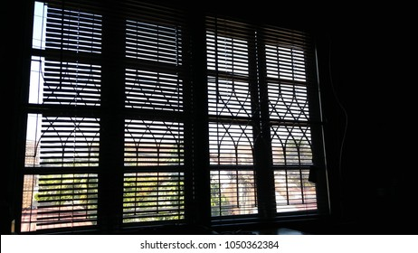 Window blinds slimline sun gives a dark room.