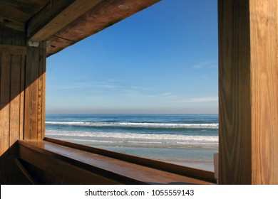 window with blue sky and surf