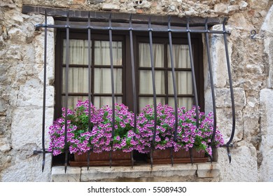 Window box of geraniums in a Provencal house in St Paul de Vence on the Cote d'Azur