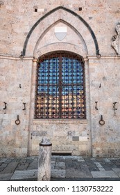Window and brick wall in Italy