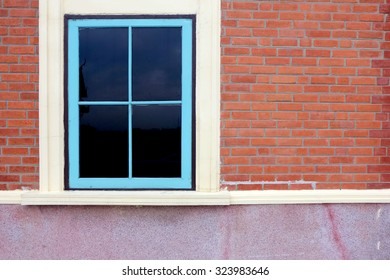 window and brown brick wall background