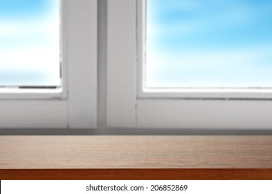 window and brown desk