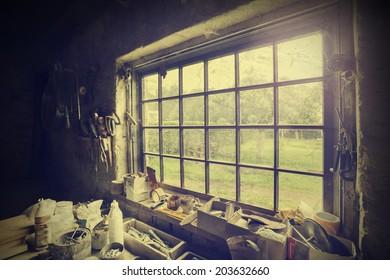 Window in carpenter's workshop, vintage style.