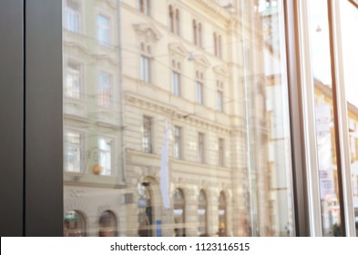 Window in a city street with an empty surface on the glass to promote the logo design and text.