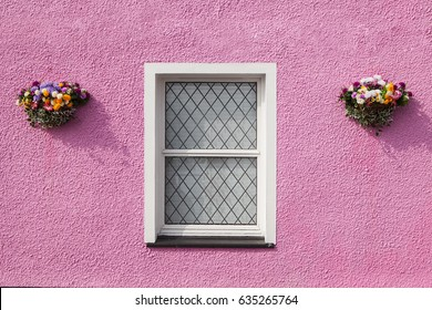 Window classic on the pink wall. color white window on the pink wall