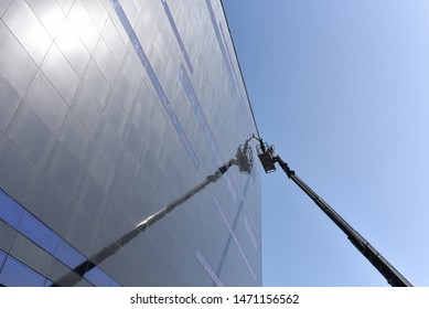 window cleaning business center with use telescopic lift