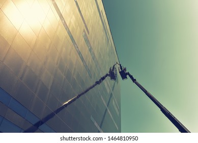 window cleaning of the facade of a modern building with a lift machine