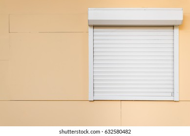 Window with closed shutters, security blinds