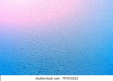 Window with condensate or steam after heavy rain, large texture or background with glare of light