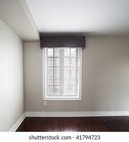 Window covering in bedroom with hardwood floor