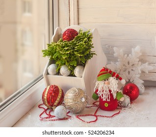 """Window decor for the holiday of St. Nicholas with toys and Selaginella martensii """"Watsoniana"""" (mass-produced)"""