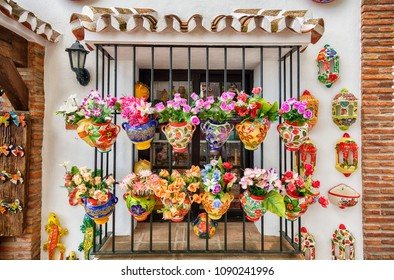 window decoration by flower pots