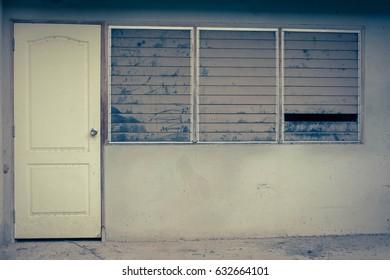Window and door of abandoned house in village