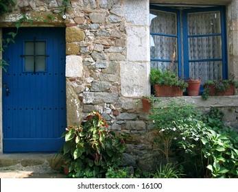 Window and door of house in Tossa de Mar, Spain.
