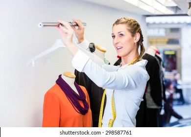 Window dresser or small business owner decorating shop display