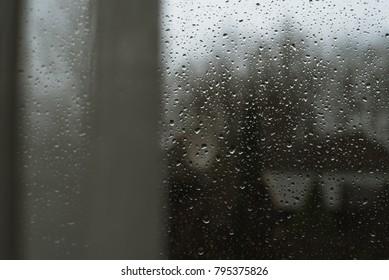 window drops of rain fall - Shutterstock ID 795375826
