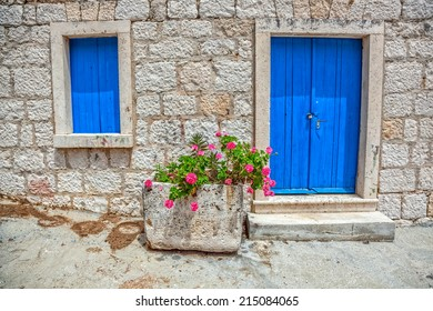 Window and entrance of an old traditional house in Dalmatia. Location on island Mljet, Croatia.