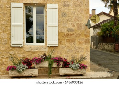 Window and flower boxes, stone house
