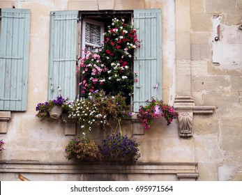 Window with flowers in Arles, France