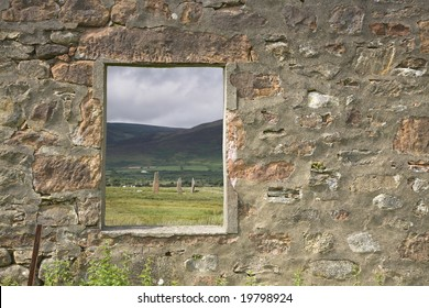 Window frame looking towards neolithic standing stones