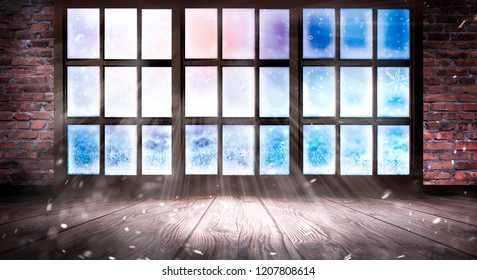 The window is frozen, frosty morning, snowflakes on the glass, an empty room with a window, an old brick wall and a wooden floor. Part of the background is a cozy interior. Sunlight squared frozen win