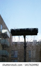 Window glass cleaning with pure water and extension pole. Washing and rinse using a reach and wash system.