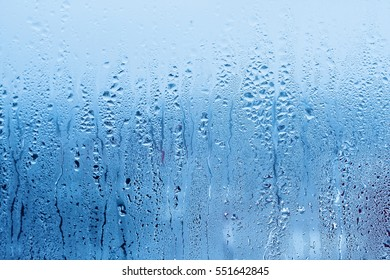 Window glass with condensation, strong, high humidity in the room