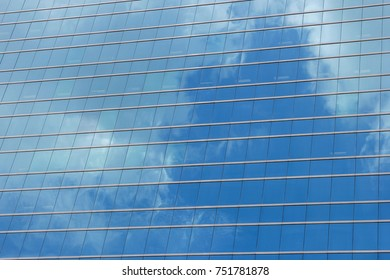 Window glass, Modern architecture in the blue sky white cloud city