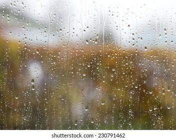 Window glass with rain drops