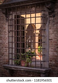 Window with grating in the ancient palace