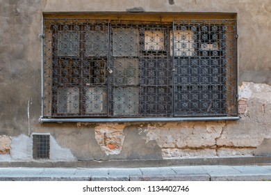 The Window With a Grating in Old Building