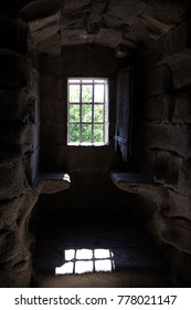 Window with grating in stone room