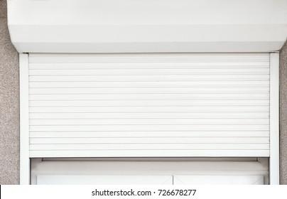 Window with half-closed roller shutter, closeup