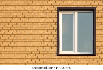 A window in a house with brick walls .