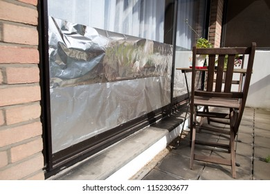 Window insulated with aluminium foil to protect house against heat wave