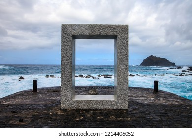 Window into the sea, famous frame sculpture with ocean background in Garachico, Tenerife, Spain