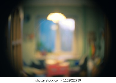 Window, lamp and table in cozy living room interior defocused image