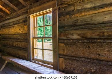 window letting in the sun light in a log cabin