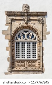 Window in the Manuelino style (Portuguese Gothic) from the Coimbras House. Braga city, Portugal.