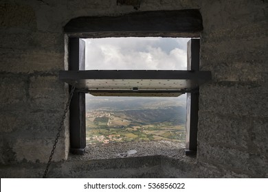 Window in a medieval castle with landscape of San Marino.