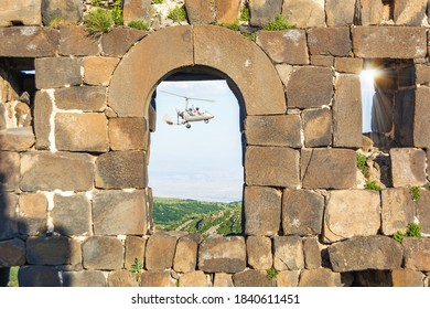 Window of a medieval fortress with a view of a beautiful landscape and a gyroplane. Armenia