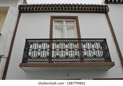 Window with metal balcony, verandah, of Ponta Delgada , Azores, Portugal