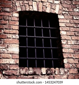 Window with metal grill as symbol of prison