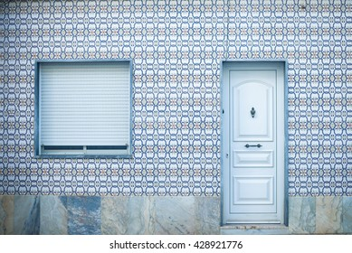 Window with metal shutter on the beautiful brown tiles wall background outdoors