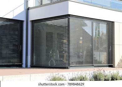 Window with modern blind, exterior shot