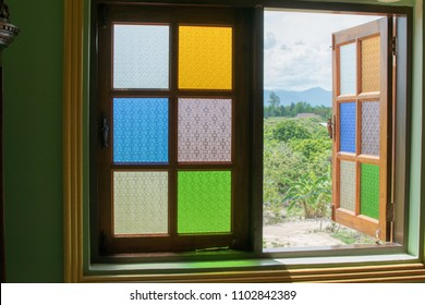 The window is a multicolored mirror. The reflection is beautiful. pattern vintage