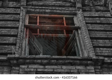 The window of the old creepy abandoned scary house in which lives a Ghost and a murder. The bloody red stains on the window.