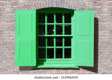 Window in old English warehouse building painted neo mint shade of green